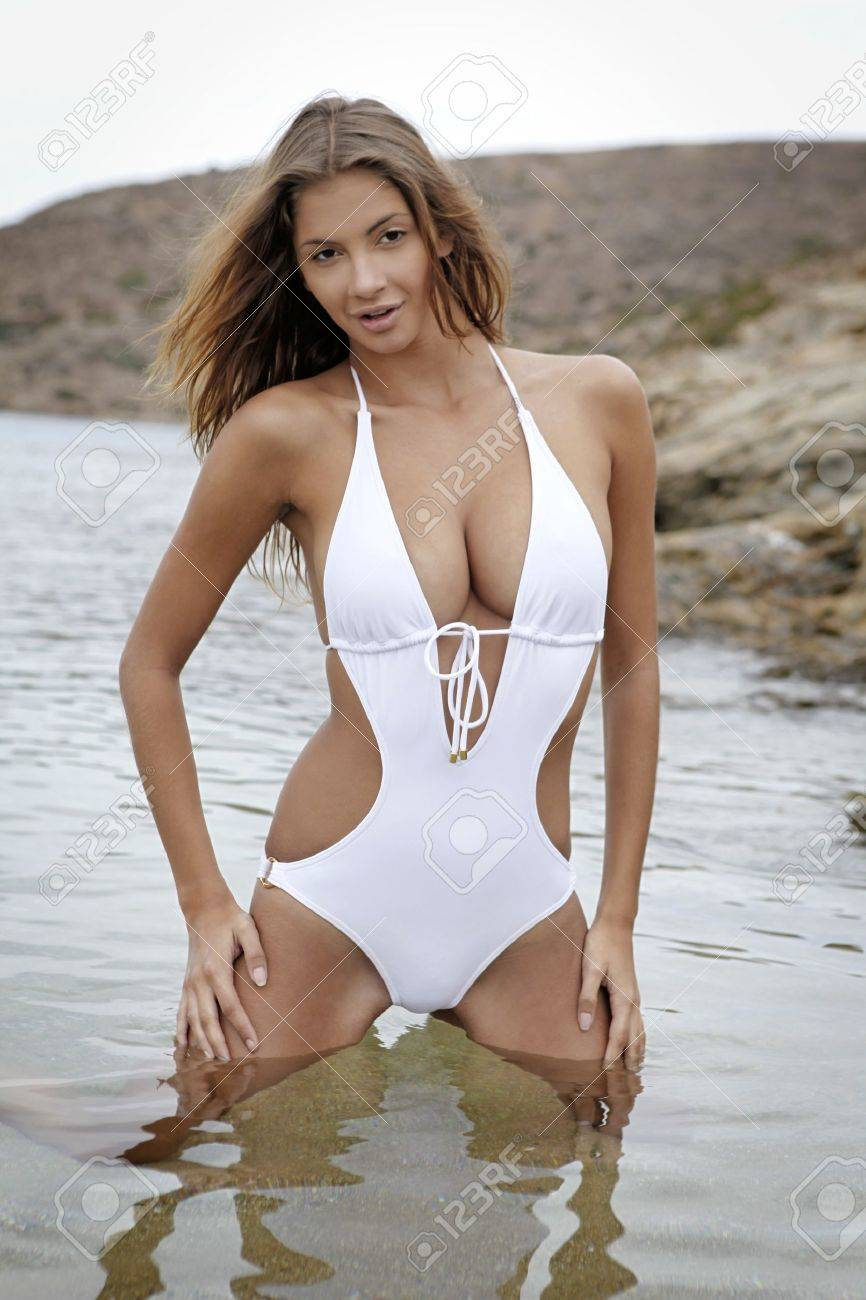 Young fashion brunette woman in swimwear on the beach Stock Photo - 8814569