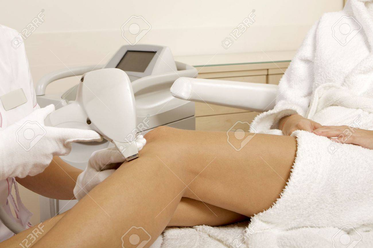 Young brunette woman receiving laser therapy  Spa studio shot Stock Photo - 15448572