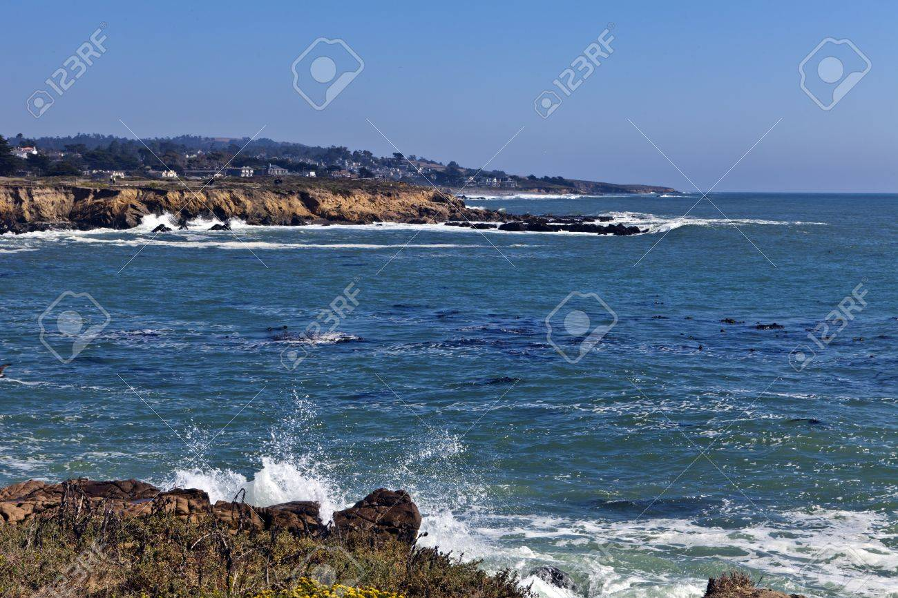 Surf crashes against the rugged shoreline at the north end of Moonstone Beach in Cambria, California. Stock Photo - 10628034
