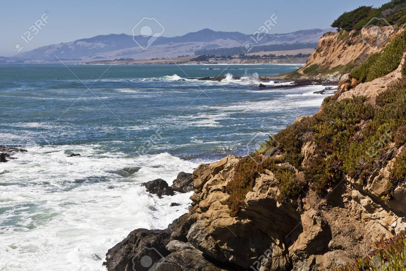 Rocky, iceplant-covered cliffs plunge to the sea along the coastline near Cambria, California Stock Photo - 10628035