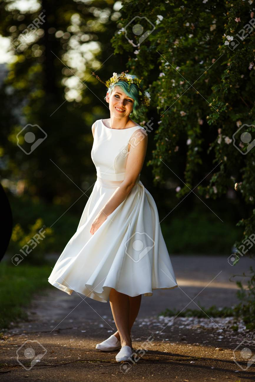 Portrait of a beautiful bride with blue hair and a wreath of stock portrait of a beautiful bride with blue hair and a wreath of real flowers wedding izmirmasajfo