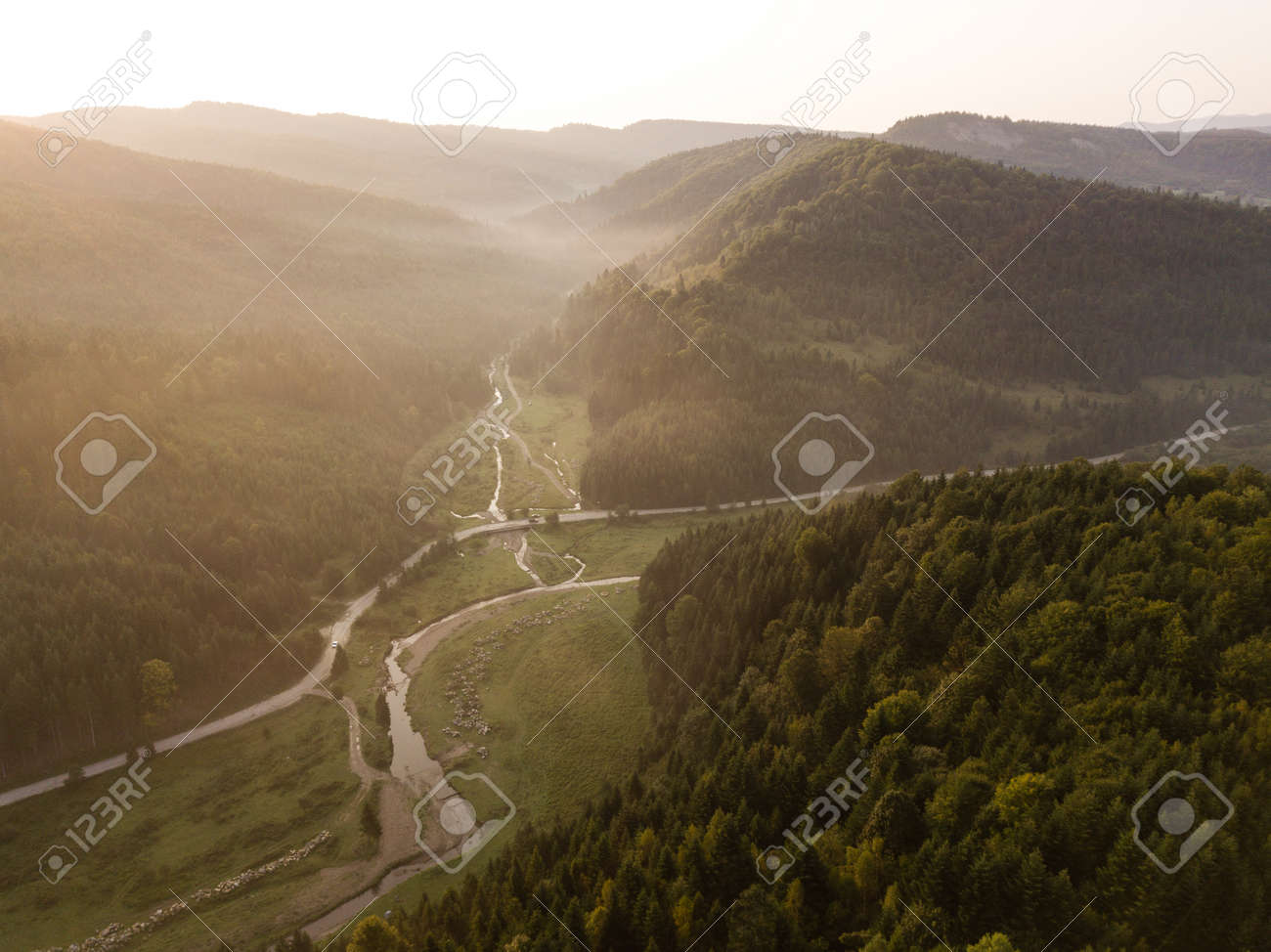 Spectacular aerial view to road with moutains captured from above at sunrise, carpathians mountains - 167297947