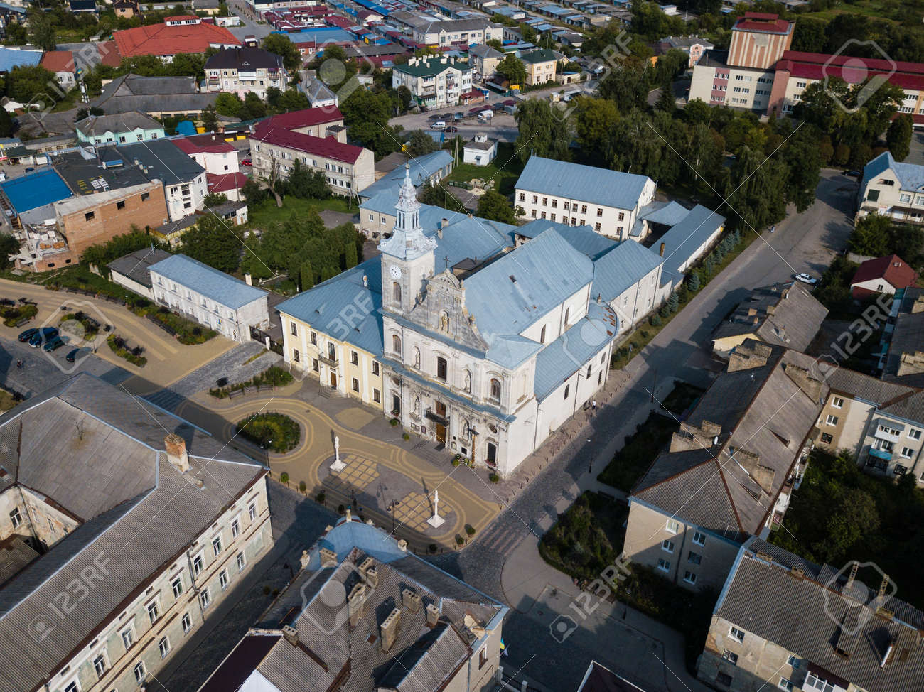 Aerial view to Church of the Assumption of Blessed Virgin Mary and center of historical city Zolochiv, Lviv region, Ukraine - 169051594
