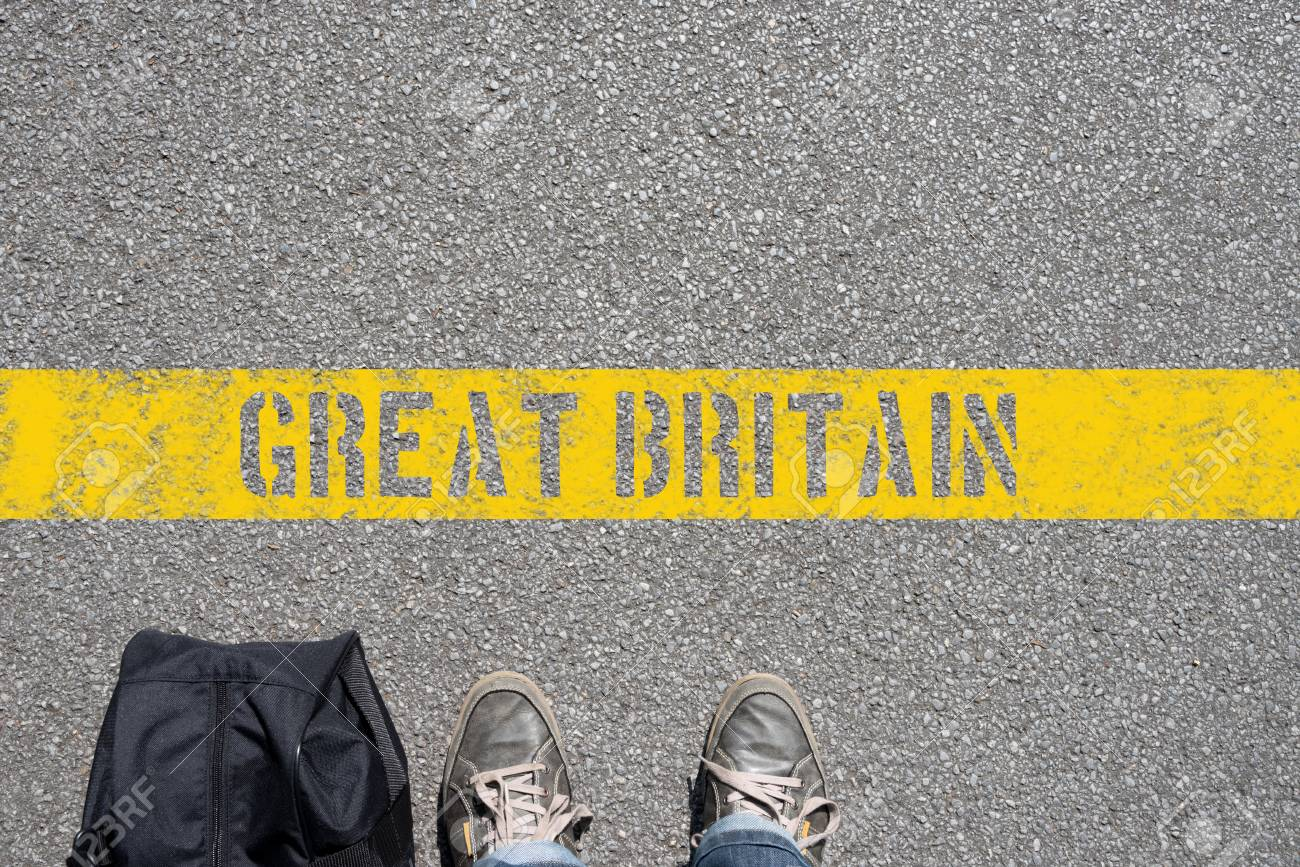 A man with a suitcase is on the border with Great Britain - 97879569