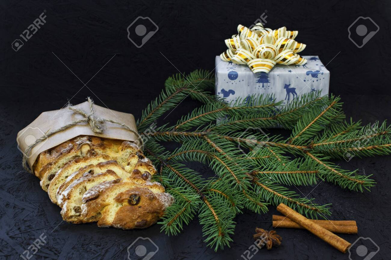 German Christmas Decorations.Traditional German Christmas Pastry Stollen On A Black Background