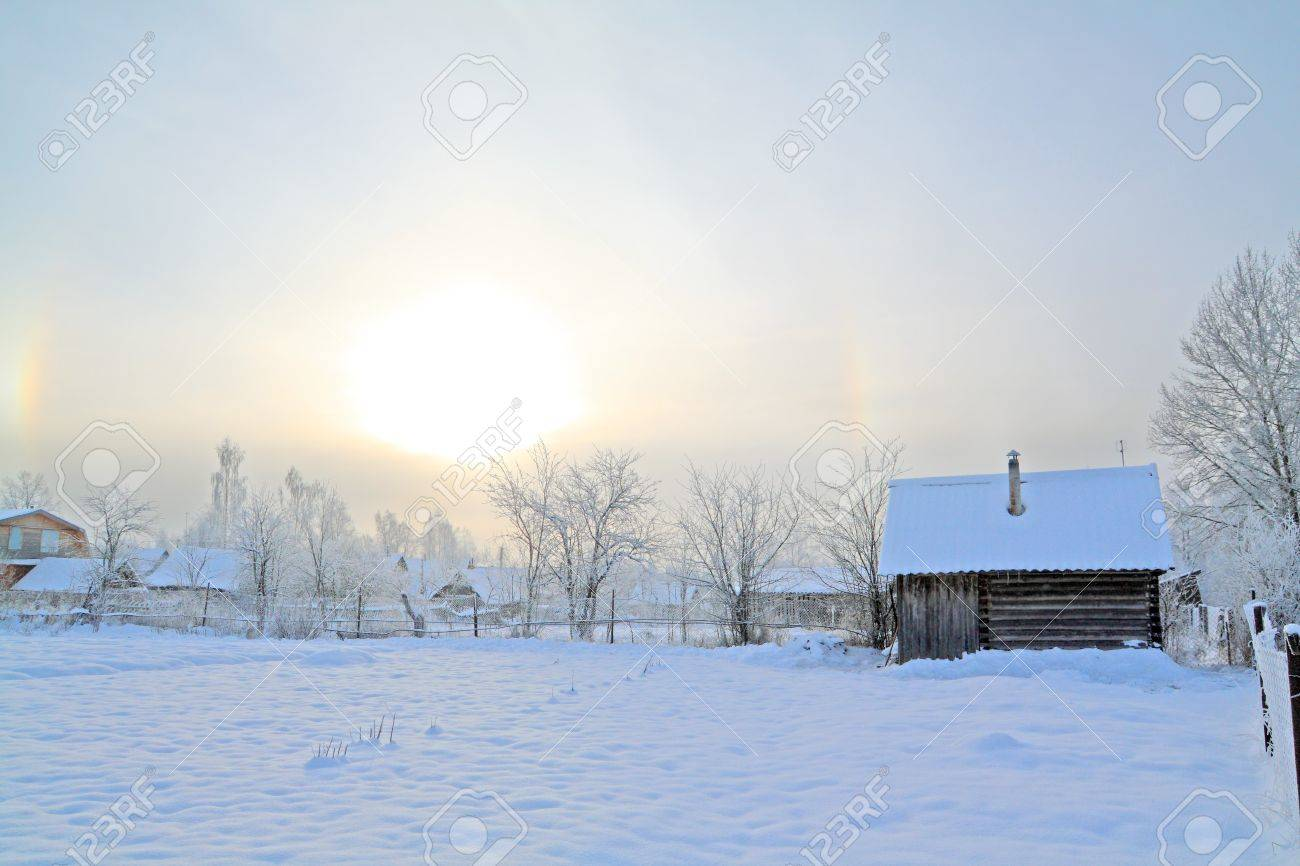 winter sun on snow village Stock Photo - 10811665