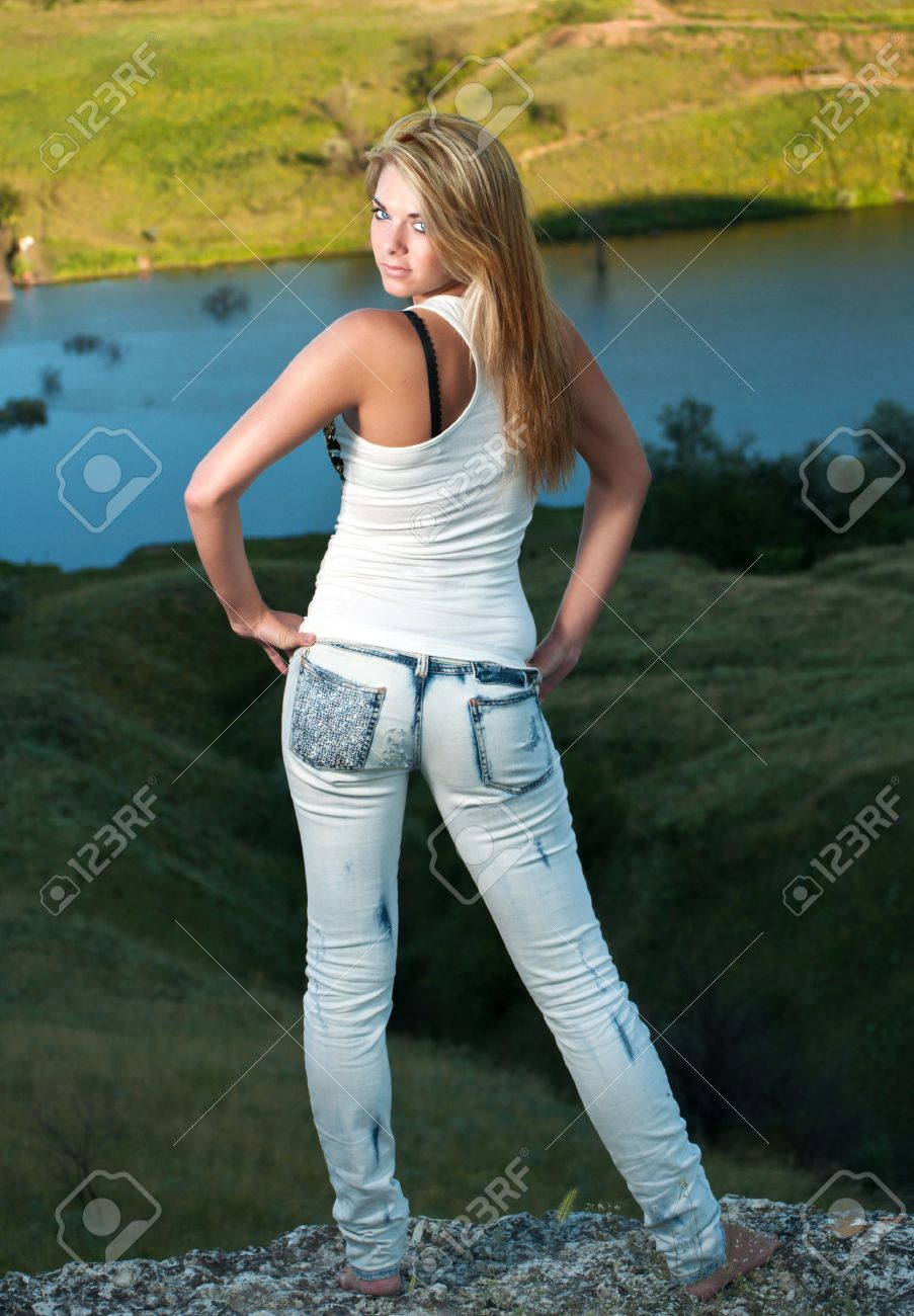 Rear View Of A Sexy Young Blue-eyed Blonde In Jeans And White ...