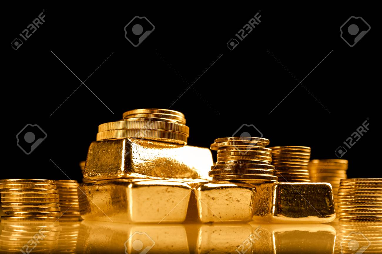 Gold bullions and stack of coins. Background for finance banking concept. Trade in precious metals. - 117887332