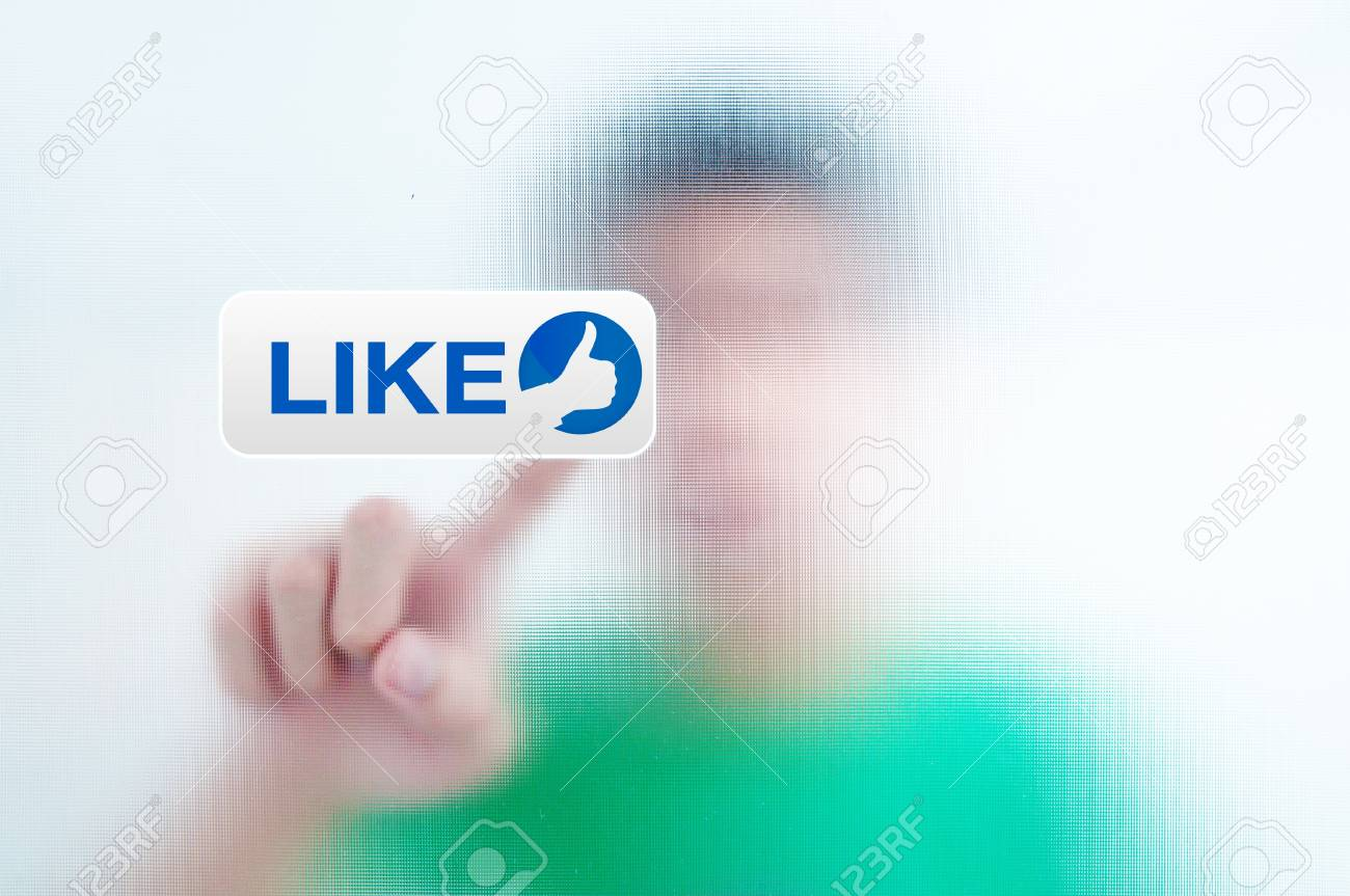 man pressing a touchscreen like button Stock Photo - 10430356