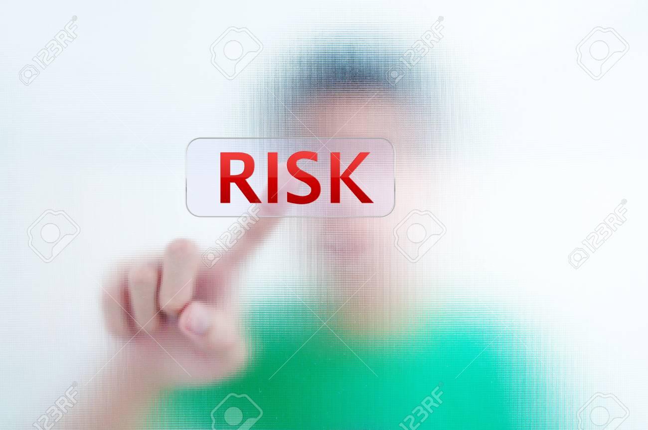 Businessman point finger on RISK wording Stock Photo - 11071346