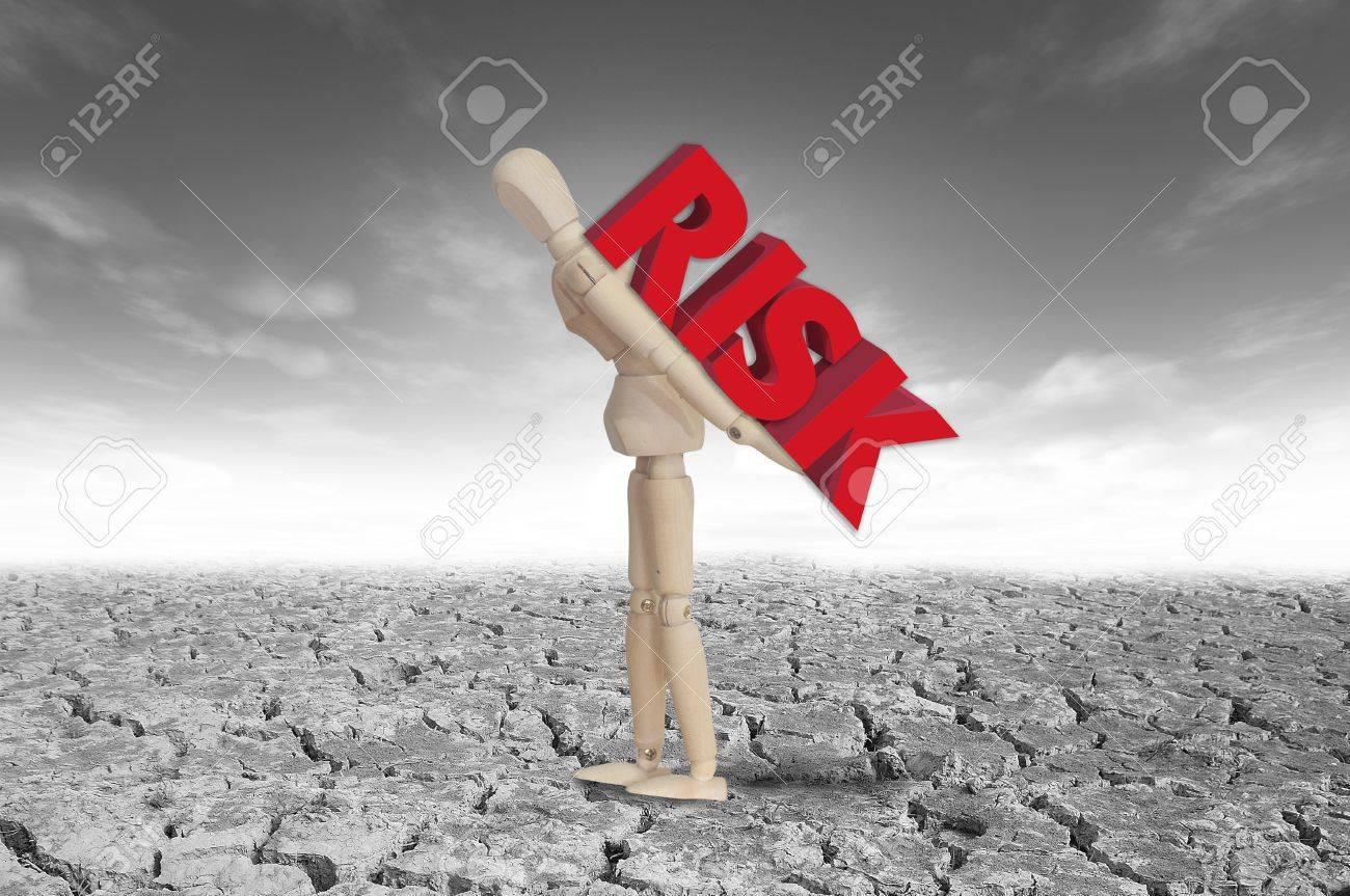 Wooden model and risk text Stock Photo - 12761704