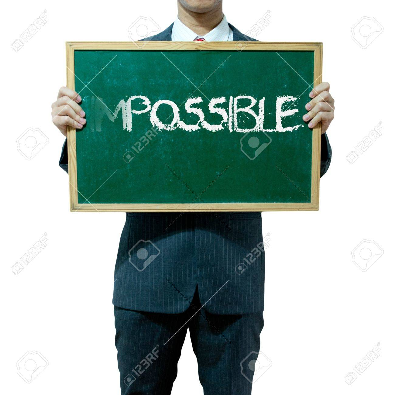 Business man holding blackboard on the background , Impossible Stock Photo - 15356495