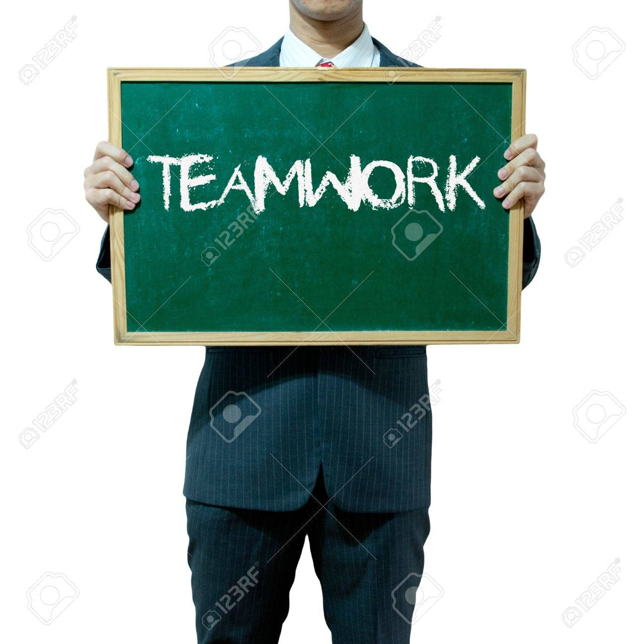 Business man holding blackboard on the background , Teamwork Stock Photo - 15356512