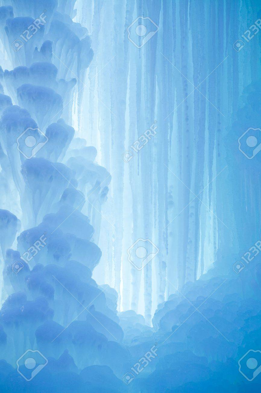 A frozen waterfall with ice in a blue and white color in winter Standard-Bild - 5918841