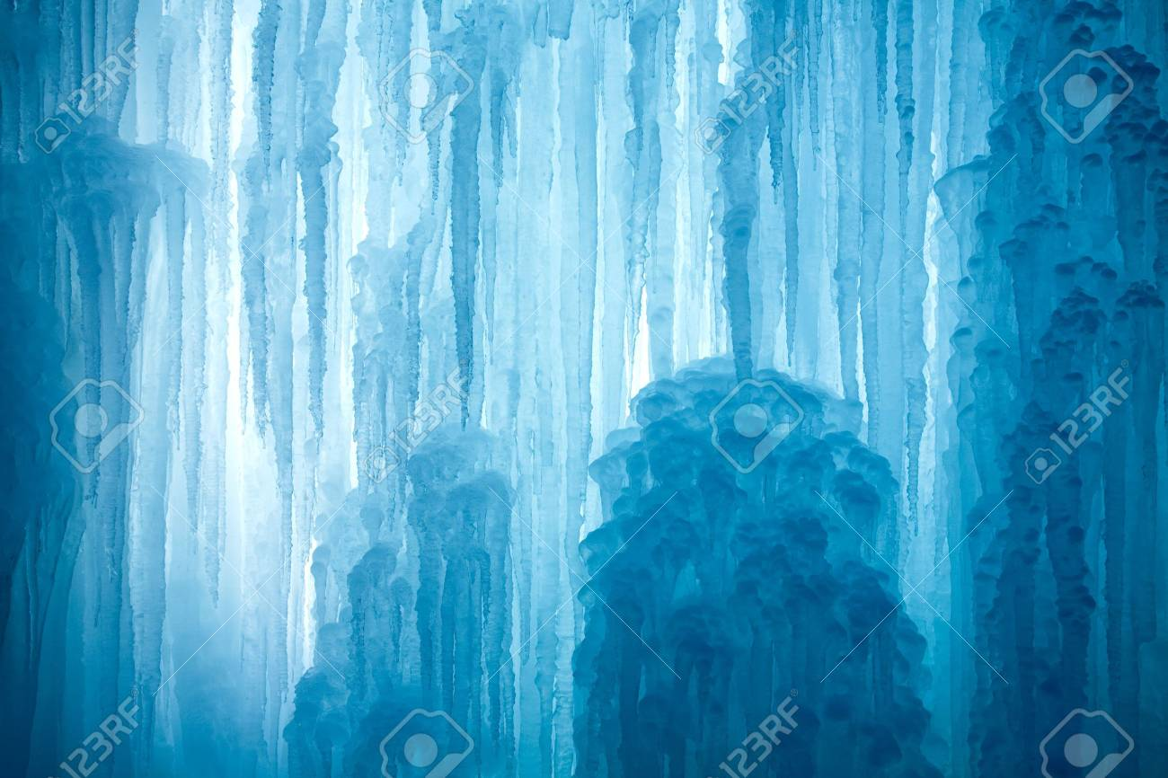 A frozen waterfall with ice in a blue and white color in winter Standard-Bild - 5918803