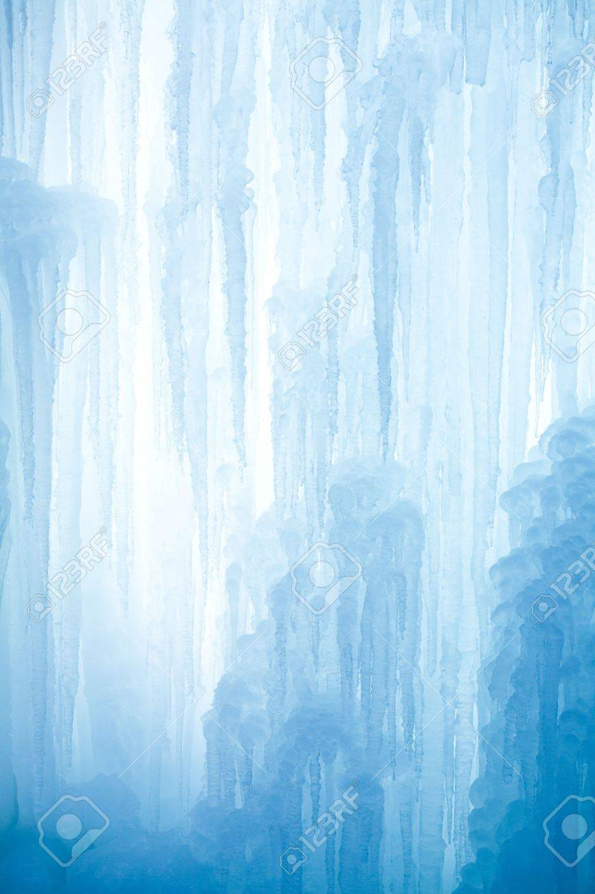 A frozen waterfall with ice in a blue and white color in winter Standard-Bild - 5918806