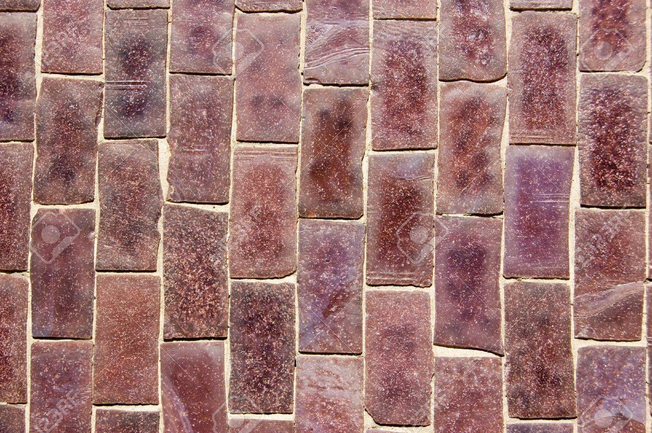 Close up of a wall covered in purple mosaic ceramic tiles stock close up of a wall covered in purple mosaic ceramic tiles stock photo 14240303 dailygadgetfo Images