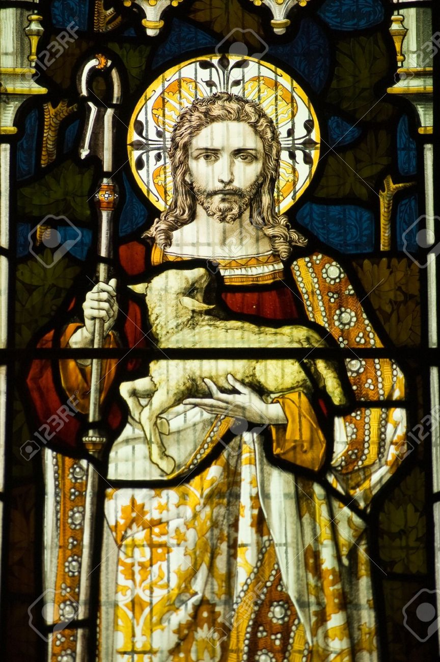 victorian stained glass window showing jesus christ and the lamb