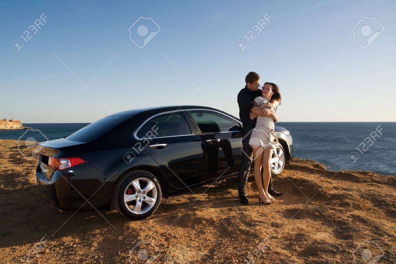 A happy family beside their new kind of cars Stock Photo - 5759095