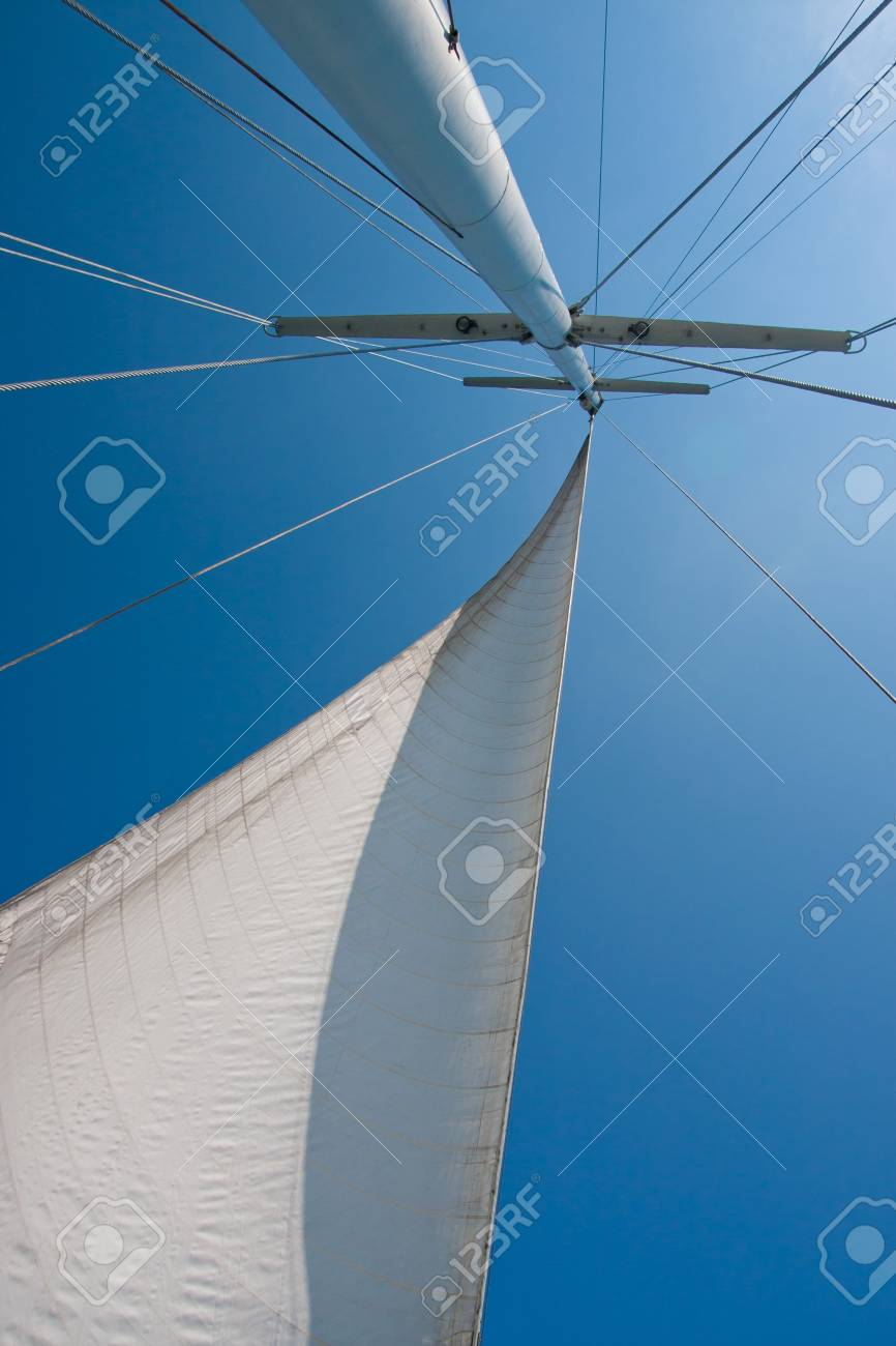 Looking up at sails and mast of boat. Stock Photo - 7456117