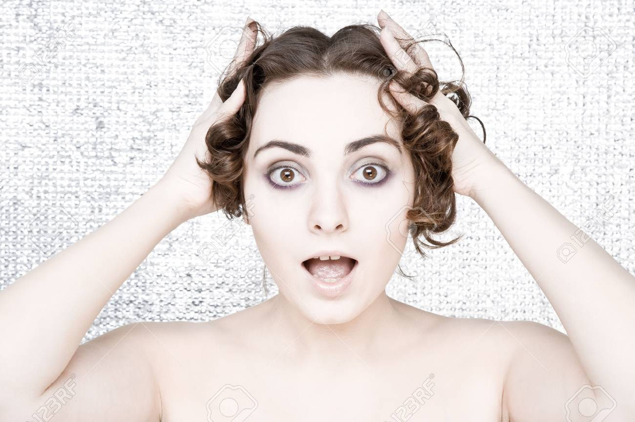 Surprised young woman with curly hair Stock Photo - 6360882