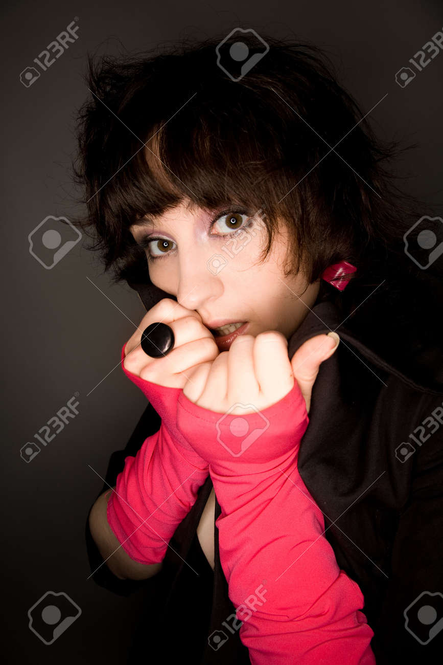 Picture of a young woman looking to the camera with fear Stock Photo - 6869548