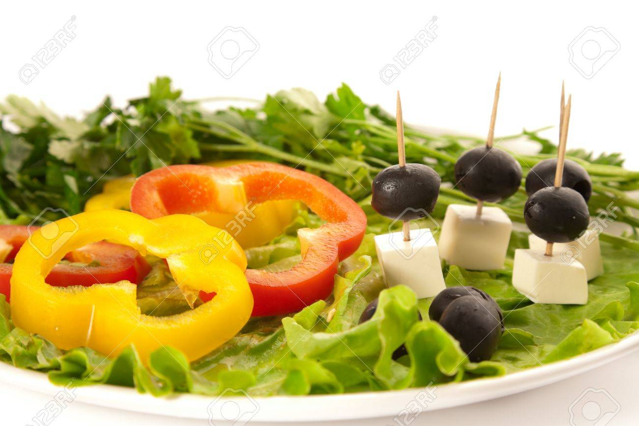 A plate of cut pepper, feta cheese, olives and lettuce Stock Photo - 7273865