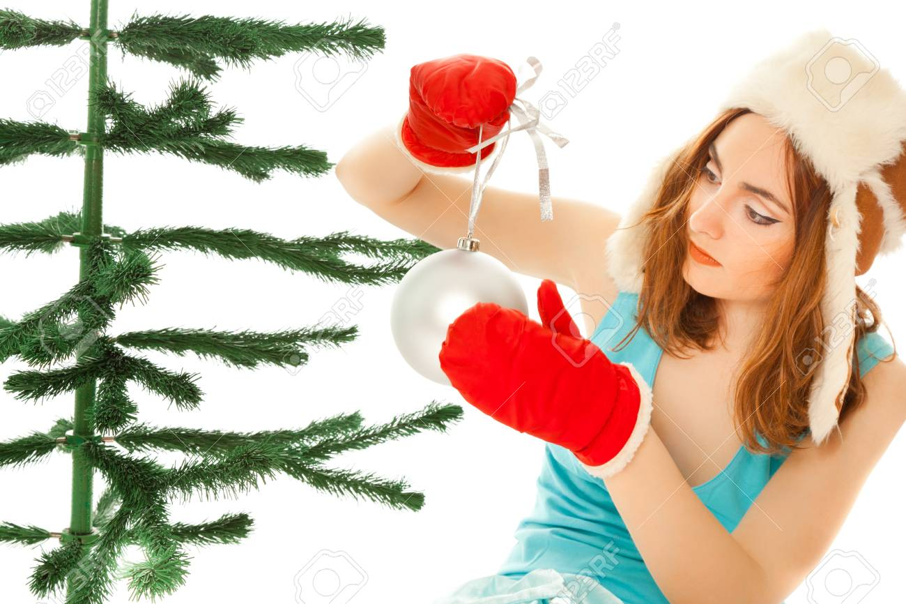 Woman's hands dressing christmas tree Stock Photo - 8481763