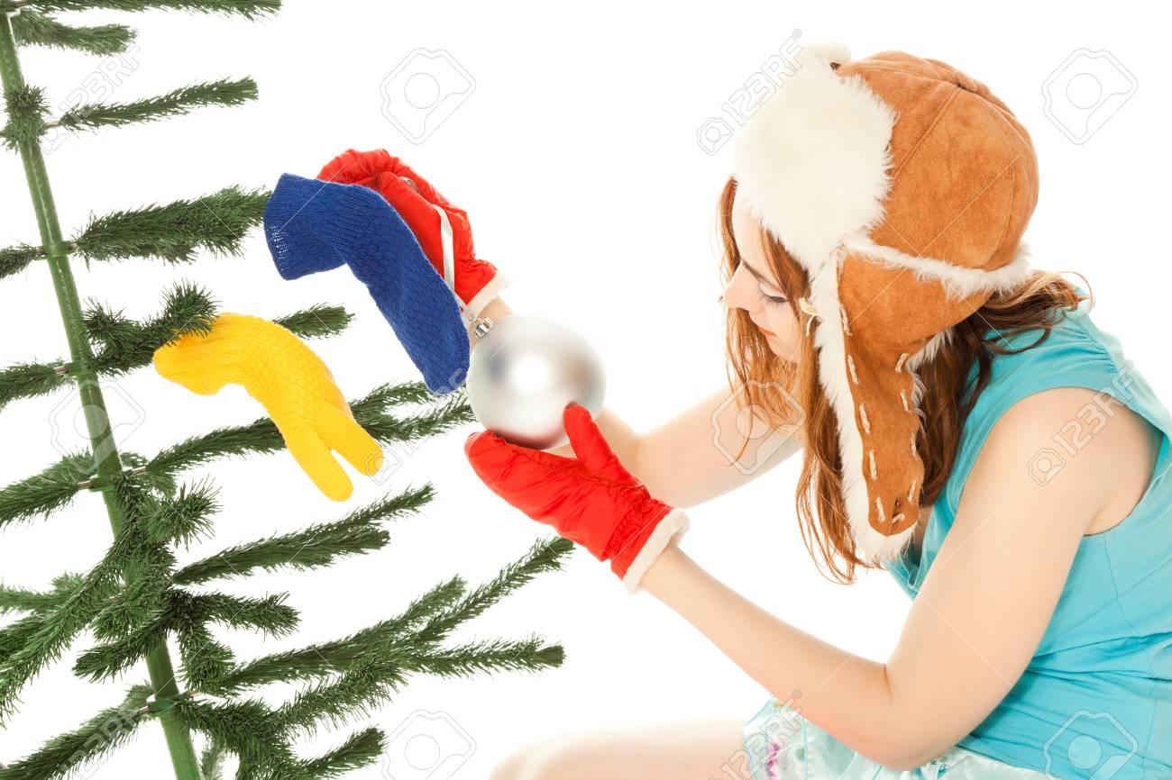 Woman dressing christmas tree Stock Photo - 8481766