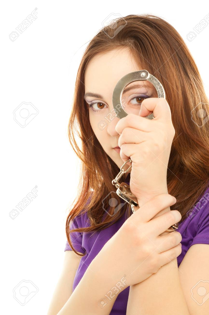 Woman looking through handcuffs isolated on white Stock Photo - 9106965