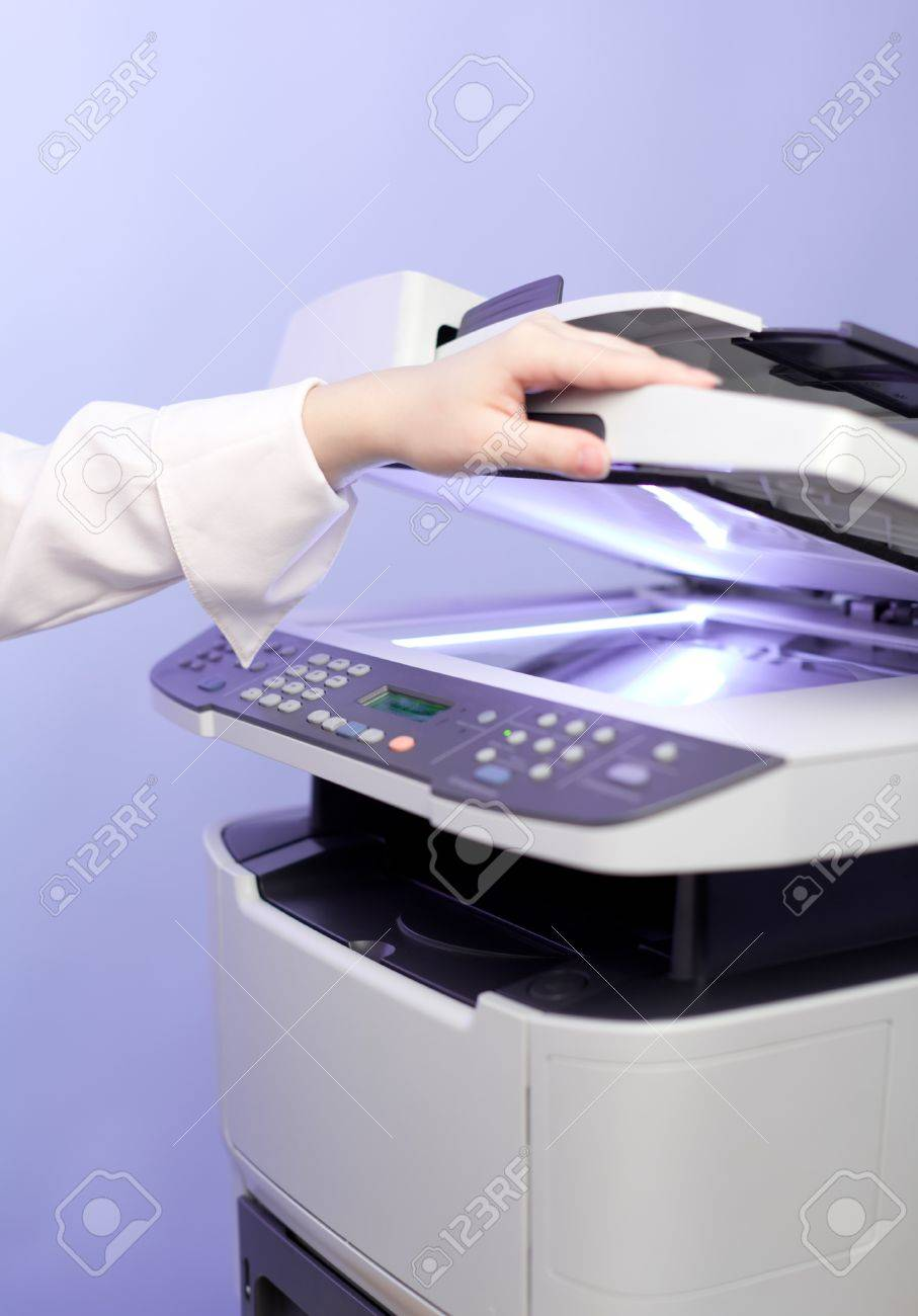 Woman's hand with working copier Stock Photo - 11958536