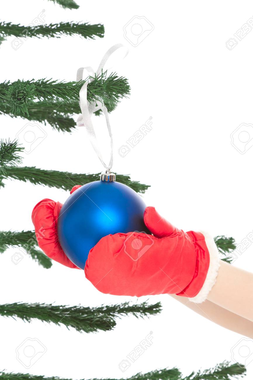 Woman s hands holding christmas toy isolated on white Stock Photo - 16582194