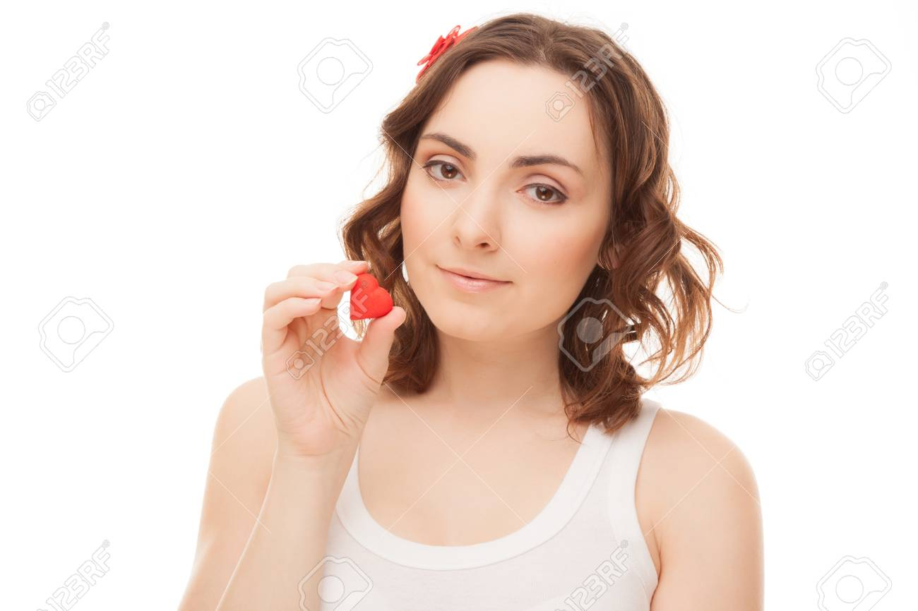 Young woman with heart shaped cookie isolated on white Stock Photo - 16881080
