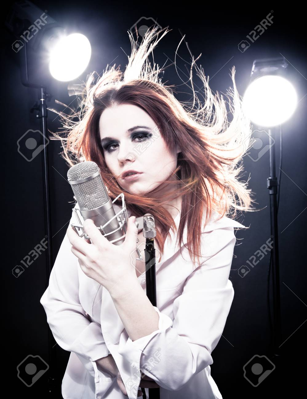Picture of woman with microphone Stock Photo - 17275720