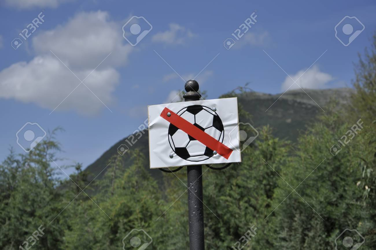 sign ban on playing football on the grass Stock Photo - 16879051