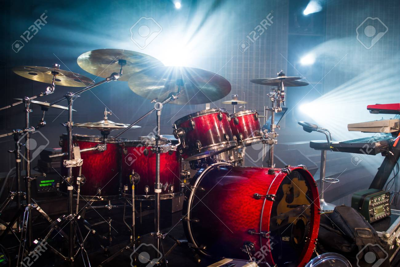 drum set on stage and light background; empty stage with instruments ready for performance - 91839821