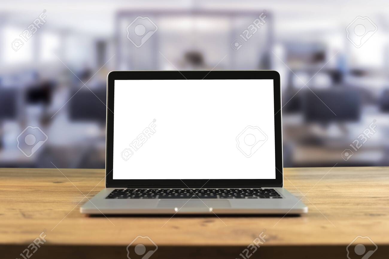 Mockup blank screen laptop on wood table in co-working space. - 148799736