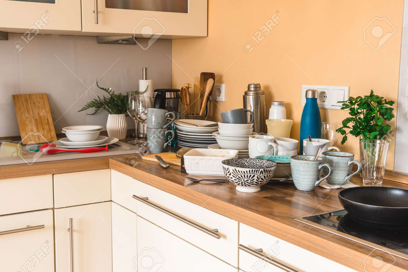 Pile of dirty dishes in the kitchen - Compulsive Hoarding Syndrome - 165807672