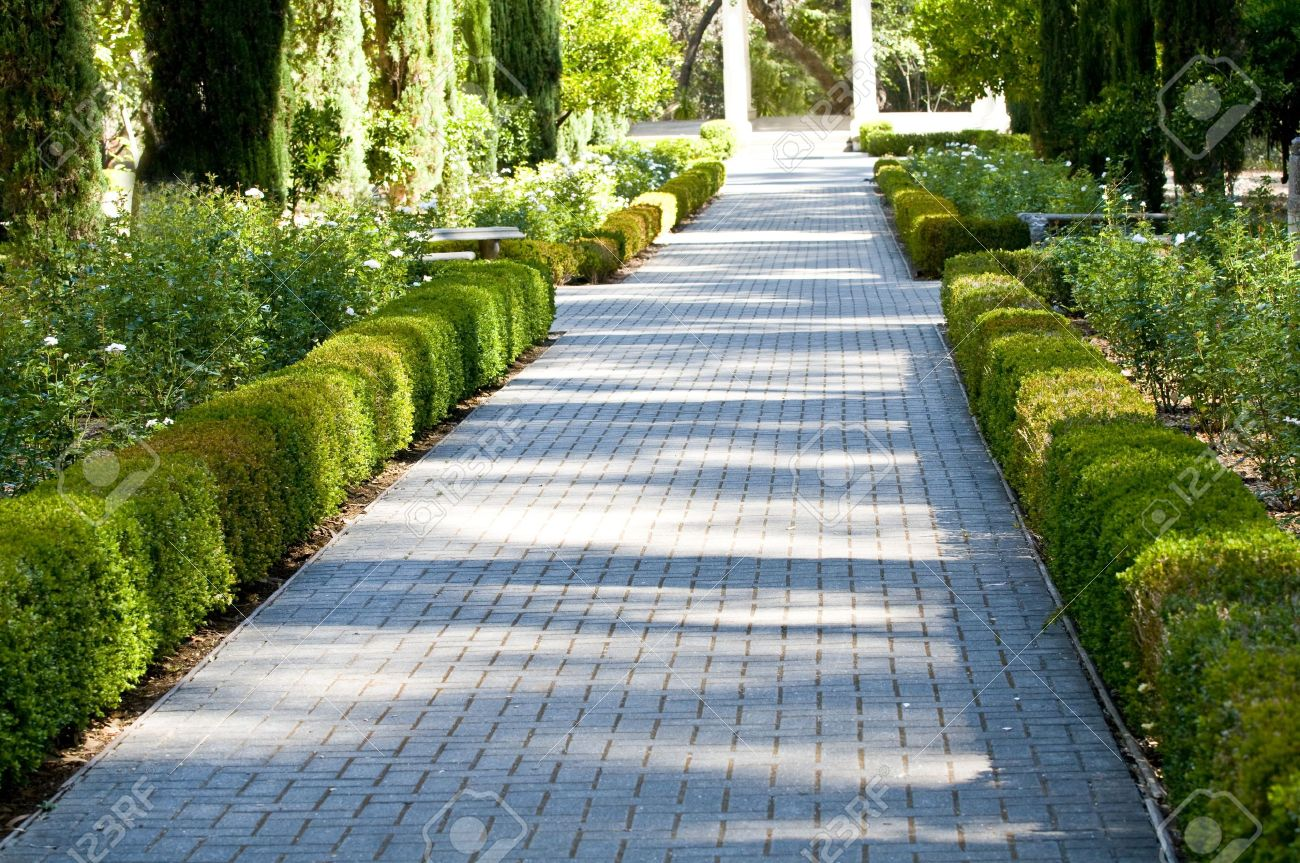 Brick Walkway Through Garden Stock Photo   5482615