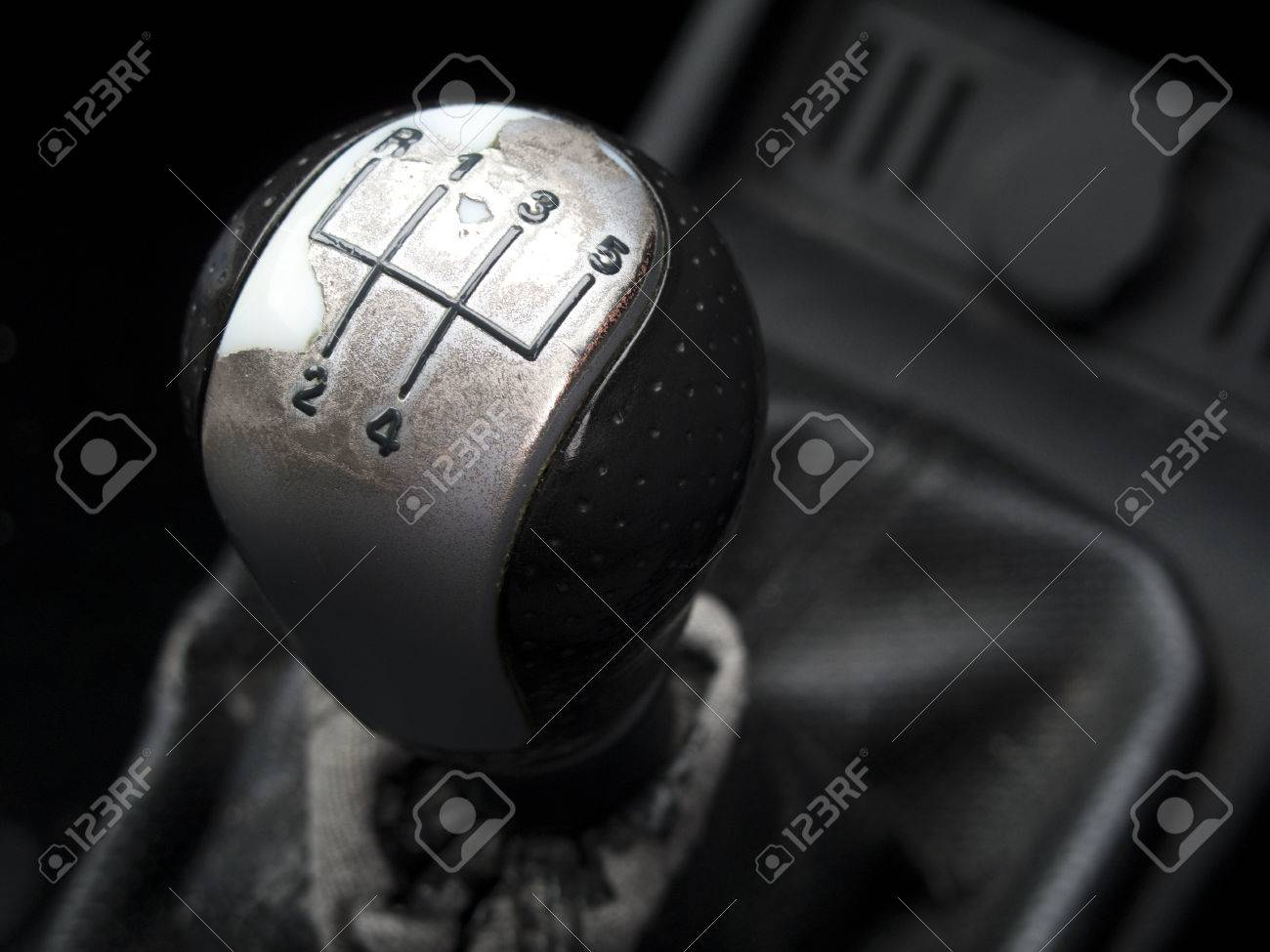 Stock Photo - Worn five speed manual car gearstick with shallow depth of  field