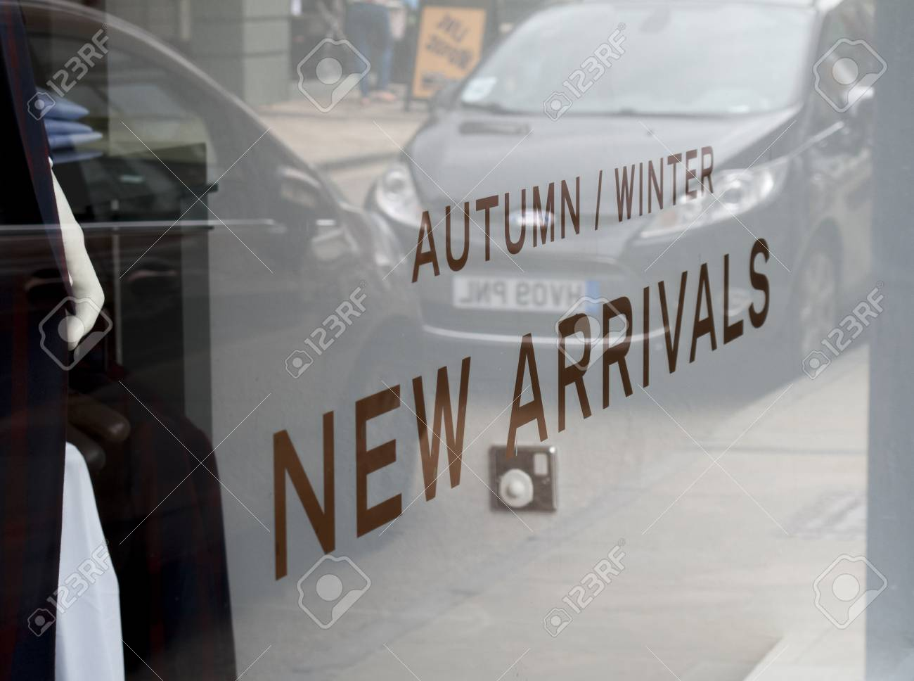 Autumn And Winter New Clothing Range Arrivals Sign In Retail Shop Window  Stock Photo, Picture And Royalty Free Image. Image 84306089.