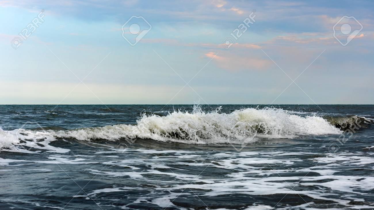 Powerful sea waves splash, natural background