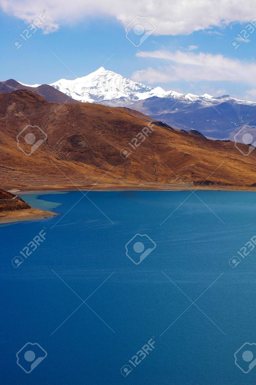 Landscape of snow mountains and blue lake in Tibet Stock Photo - 8576503
