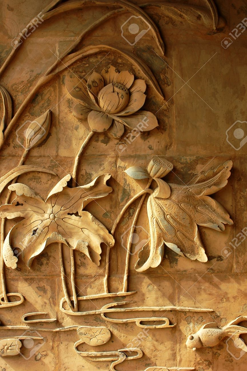 Ancient brick carving art of lotus flowers Stock Photo - 9701387
