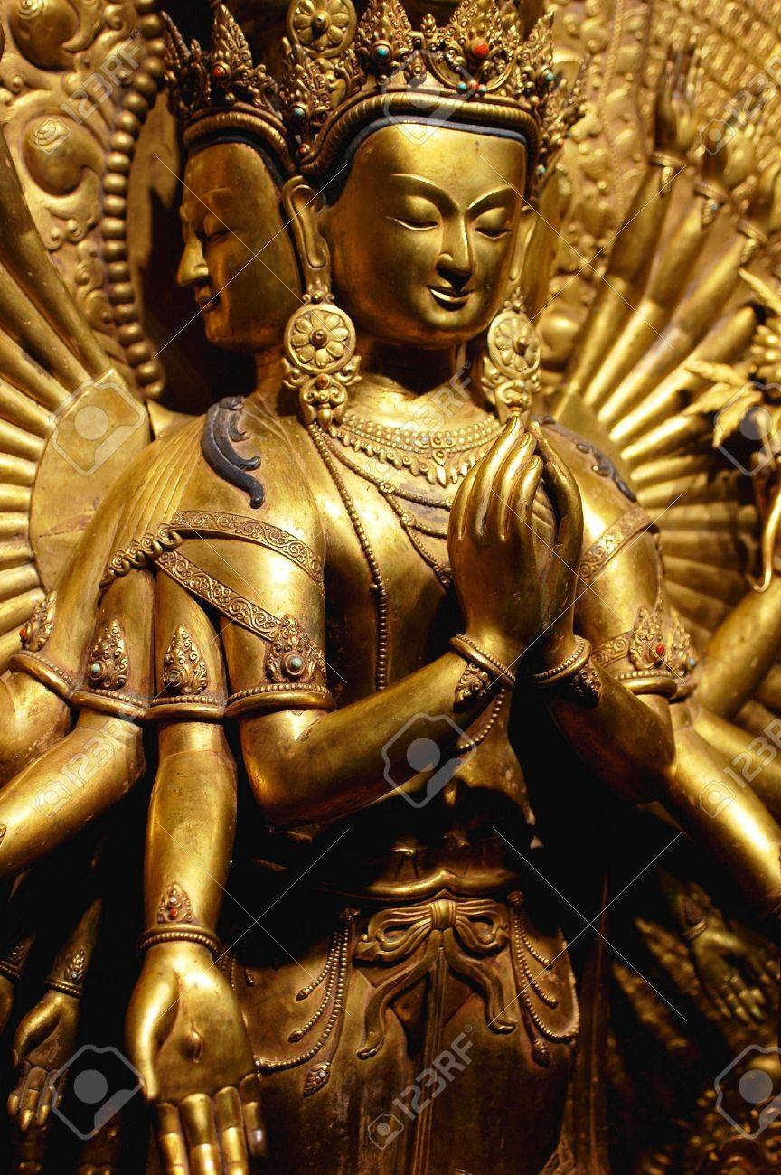 Ancient golden sculpture of a buddha with four faces and eight hands Stock Photo - 9701385