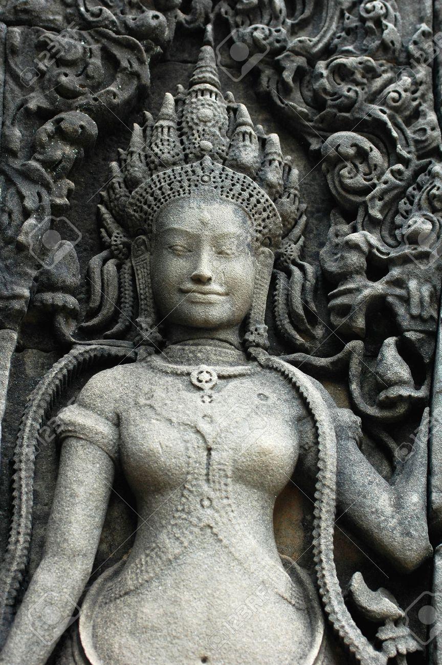 Rock sculpture of a smiling goddess at Angkor, Cambodia Stock Photo - 9802873