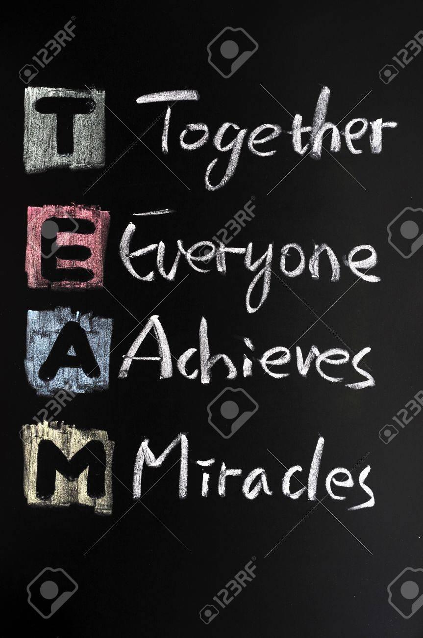TEAM acronym written in colorful chalk on blackboard Stock Photo - 11714607