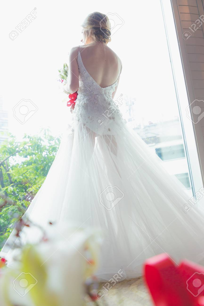 Red And White Wedding Dress.Women Blonde Hair Wear Wedding Blue Rings In White Wedding Dress