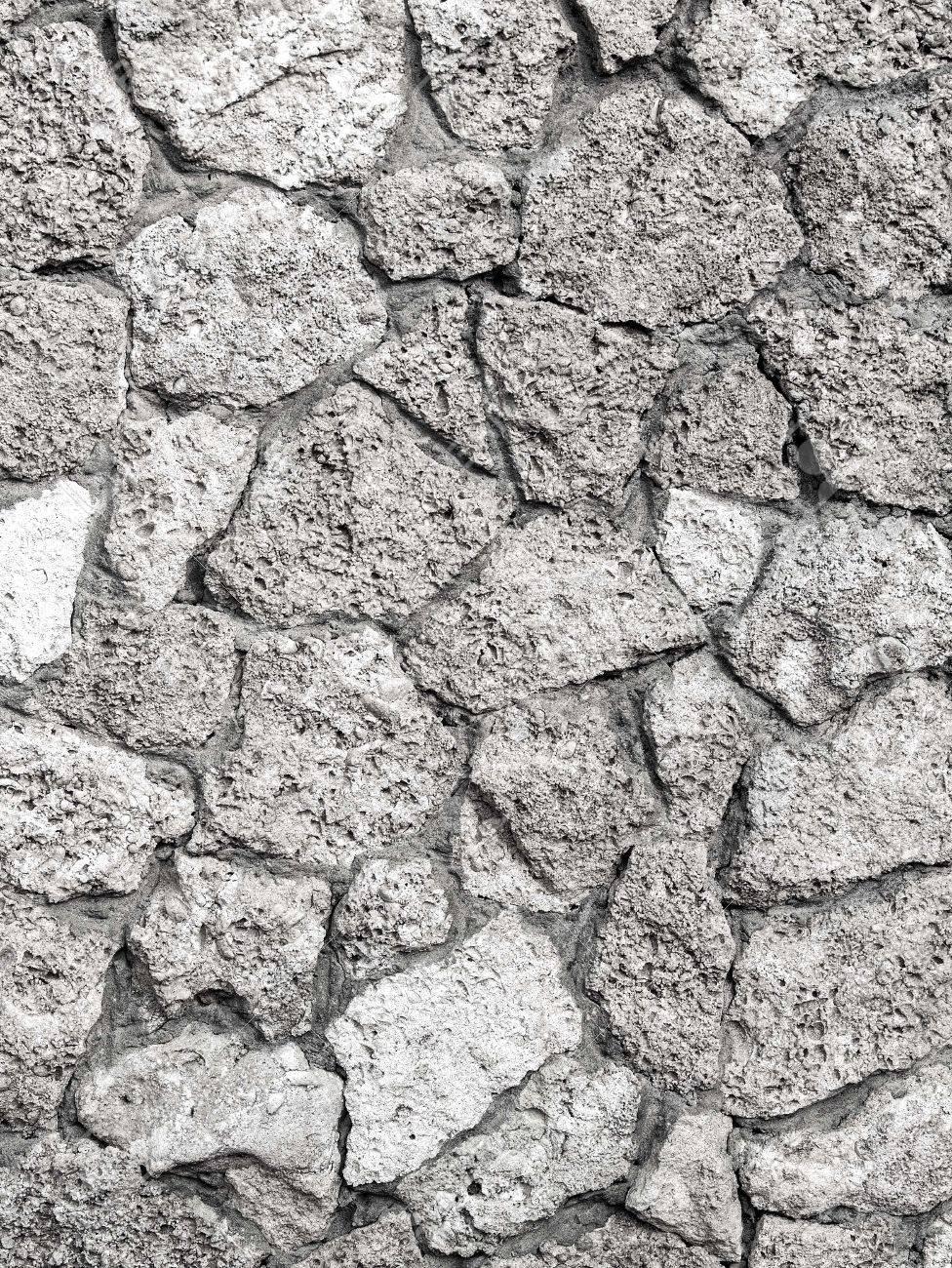 Weiße Steinwand unregelmäßige natürliche weiße steinwand strukturierten hintergrund