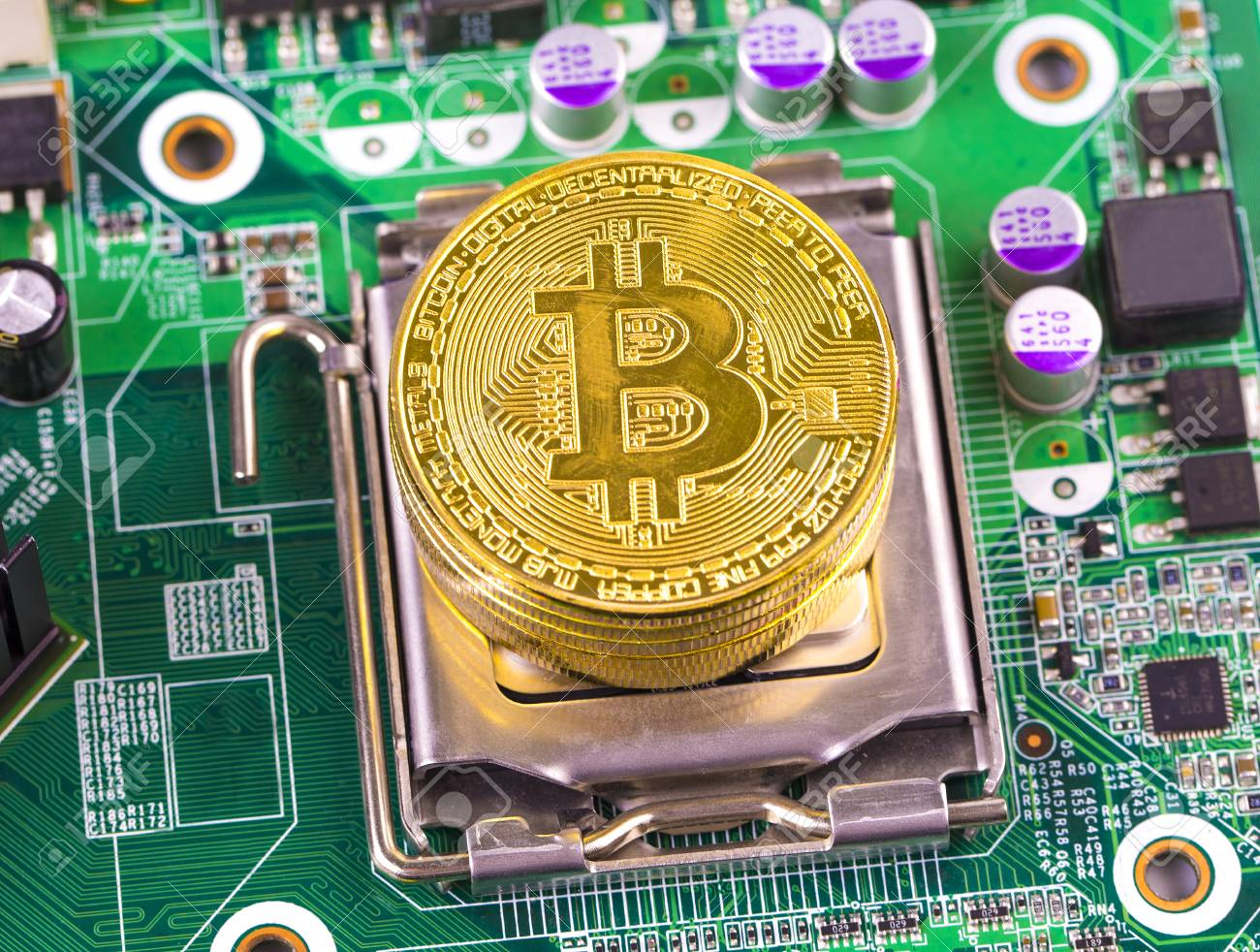 Bitcoin Concept Gold Coin Computer Circuit Board With Fm Processor And Microchips Stock